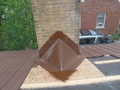 how to build a cricket behind chimney (metal roof) http://www.barnhillchimney.com/wp-content/uploads/2011/06/P6020064.jpg