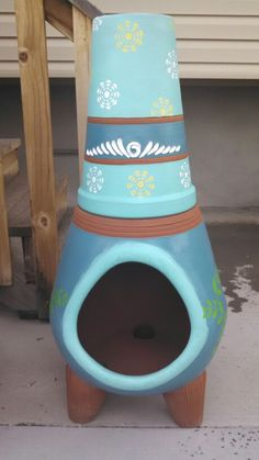 I had so much fun with this Mothers Day present. Clay chiminea from Lowes + spray paint and a few stencils.