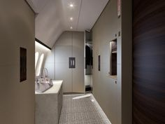 The master suite also includes this gigantic dressing room and walk-in closet. There's a refrigerator and safe as well in the suite.