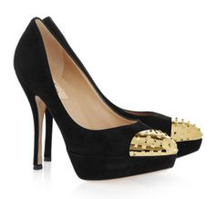 giving a simple black @valentino shoe its golden edge..