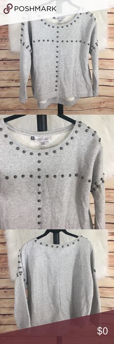 "👚Jennifer Lopez grey studded sweater ‼️Flawed item: priced accordingly‼️  Brand: Jennifer Lopez Size: M Type: grey studded sweater  Details: scoop neck, high low hem, studs accenting both sides  Bust measurement: 25"" across Length from collar to bottom: 17.5"" Length from shoulder to bottom: 25"" Condition: preloved: good *one stud is loose & dangling by threads as pictured in pic 7  ✨Build a bundle with all your likes and use the automatic bundle discount -or- make me a bundle offer✨…"