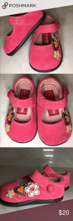 New Genuine Kids made of Sued and details These are new Baby shoes that close with Velcro and have rubber soles. They are adorned with flowers and a heart. The colors are fuchsia, purple, light green, orange and a metallic pink. Genuine Kids Shoes Dress Shoes