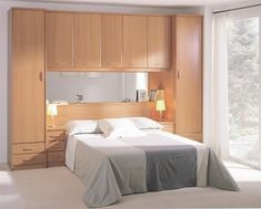 Built in closets around bed 20 140 closet around bed for Closet para cuartos matrimoniales