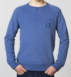 BOYS - EQIP-11 print sweater - true navy. For hockey players who also want to radiate team spirit and sportsmanship off the field.