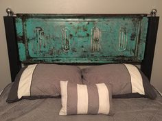 Old tailgate made into a headboard! Bed posts are trailer hitch balls.  My husband did an awesome job making it!