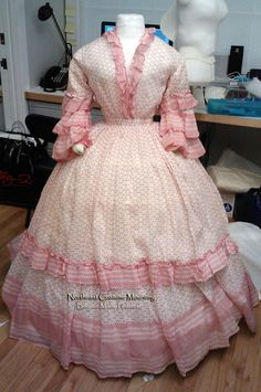 Dress ca. 1855. Spotted cotton with à la disposition-style trimmings. Northeast Costume Mounting