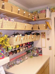 a nicely organized craft room using baskets and this would work for my laundry room also