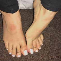 Simple white pedicure and toe rings