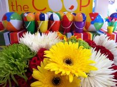 Love the favors... sand buckets topped with mini beach balls