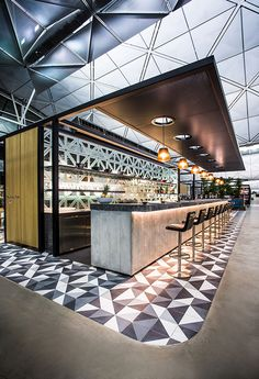 Installation of our cement tile in the QANTAS Hong Kong Lounge