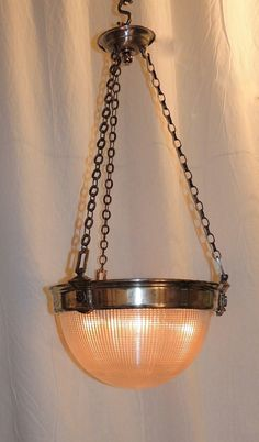 View this item and discover similar for sale at - This vintage beautifully aged silvered nickel chrome bronze chandelier with an original holophane frosted ribbed glass bowl with deco accents around the Bronze Chandelier, Chandelier Pendant Lights, Modern Chandelier, Chandeliers, Chrome, Pendants, Ceiling Lights, Antiques, Glass