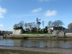 Wales - The east side of Cardigan castle seen across the river Teifi. The large white building is a large 19th century house that incorporates the keep.