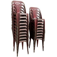 Tolix Chairs in Original Burgundy Color  France  Circa 1920  Tolix metal bistro chair with unusual original burgundy color, classic form, also stacking. Priced individually. (18) Available