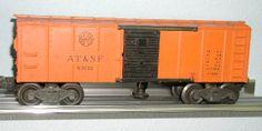 Lionel postwar # 3464 Santa Fe operating boxcar.