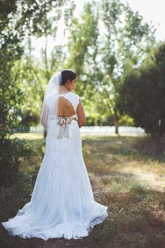 So smitten with this open back wedding dress!