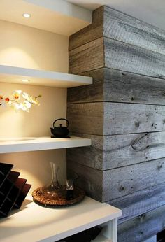 Nice fireplace surround / feature wall made with reclaime grey barn board from www.Barnboardstore.com