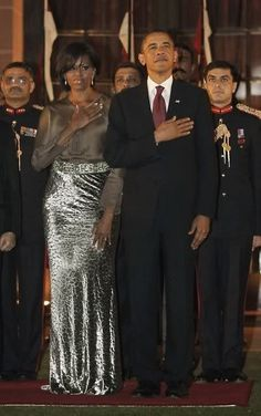 They stand TALL and STRONG side-by-side... Mr. & Mrs. Obama