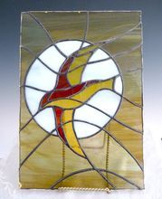 Vintage stained glass bird panel sunset