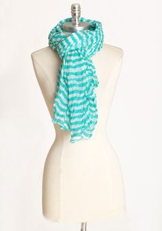 """Aqua Mirage Striped Scarf 14.99 at shopruche.com. An oceanic aqua hue is paired with ivory to create stripes that are reminiscent of gentle waves. This delicate and ever-so soft scarf is finished with luxurious texture for a unique look.100% Polyester, 72"""" long"""