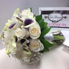 Bridal bouquet, ivory roses and calalillies.