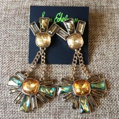 Sam Edelman Jeweled Dangle Cluster Earrings Sam Edelman Cluster Drop Earrings with Gold and Blue Green Tones  Gold-tone earrings with chain-suspended drops featuring multicolor resin accents. Post with friction back. 2.9 x 2.9 x 0.7 Never been worn, NWT. Retail $35 Sam Edelman Jewelry Earrings
