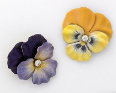 """always on the lookout for black and gold...these sold at auction in 2008. Here's the description: TWO ENAMELED GOLD PANSY BROOCHES WITH DIAMONDS 14k yg, ca. 1910-1920. Pansy shaded purple with hinged pendant bail, centers OMC diamond, approx. .40 ct. TW. The other pansy, shaded yellow, centers OMC diamond, approx. .30 ct. TW. 31.5 gs. GW. Each 1 3/8"""". LIst price was > $1000 for the pair."""
