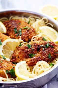 Crispy, tender and juicy parmesan crusted chicken over the most incredible creamy lemon garlic pasta! This is a must make meal! My baby is turning two in just a few months. I am seriously crying big
