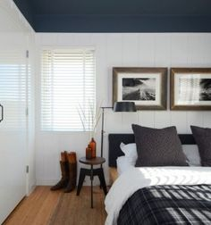 Board and batten with navy blue ceiling and gold frames