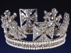 The Diamond Diadem, 1820. Queen Elizabeth wears this on her journey to and from the State Opening of Parliament. It was made for George IV. It contains 1,333 diamonds and pearls.