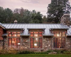 Stone exterior with metal roof and large windows for a unique style #home #remodel #kitchen #bathroom #dogoodwork www.jimhicks.com