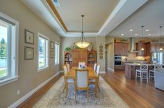 The dining room is so large that the homeowner can add extra tables for entertaining. Designed and built by Quail Homes of Vancouver Washington.