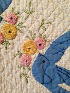 Detail of Applique Blue Birds, by Mary Hammer Faulders. Donated by Bromleigh and Mary Louise Lamb. Courtest the Latimer Quilt & Textile Center.