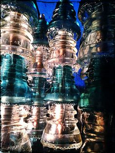 This is a new fountain I made from glass insulators and copper pipe...