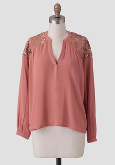 Rendered in a gorgeous burnt-peach hue, this darling blouse features a V-cut tunic neckline with sheer lace panels at the shoulders.