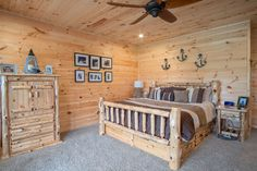 the Custom Crafted wooden walls throughout this whole home are stunning! #woodwalls #cabin #lakecabin #smithlake #customhouse #masterbedroom #bedroom #barewalls #handcrafted #beautifulbedroom #carpet #bed #lakecabin #lakehouse #lakehousegoals #woodfurniture #barebarkfurniture #welcomehome #familyroom #lake #house #home #myspace #beautifullycrafted #wood #wooden #vgroove #shiplap #woodceiling #woodenwalls
