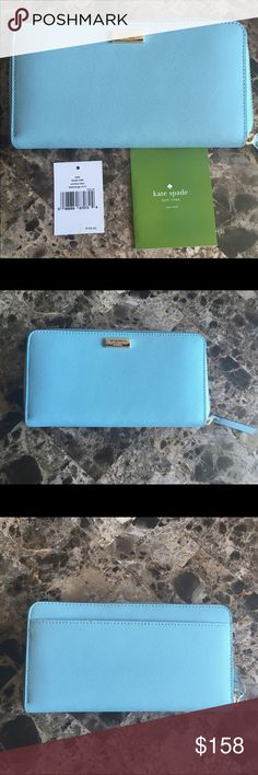 Kate Spade Neda light blue Wallet Newbury lane New with tags Kate Spade Newberry lane Wallet in light blue hydrangea.  Does not come with dust bag or box. Wallet zips all the way around, 12 credit card slots, 2 billfold slots, zipper change pocket and exterior slide pocket in outside.  Also decorated with 14 karat gold logo that has mild scratches on it.  A beautiful light blue color hydrangea.  I took many photos to show authentication and color in various lighting.  See my other listings…