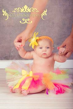 Easy pose idea for 3 month old baby photo idea and use of props