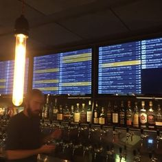 Photo of Taphouse - København, Denmark. 61 beers on tap! Live screens telling about the selection.
