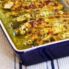 Baked pesto chicken. yum! i lined the baking dish with aluminum foil and used jarred basil pesto. i'm definitely making this again.