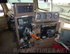 "Control Stand:  A control stand is a diesel-electric locomotive subsystem which integrates engine functional controls and brake functional controls, whereby all functional controls are ""at hand"" (generally, within the operational radius of the locomotive engineer's left forearm from his customary seating position, facing forward at all times). RailPictures.Net Photo: MBTA 1003 Massachusetts Bay Transportation Authority (MBTA) EMD F40PH at Somerville, Massachusetts by Christopher Kelliher"