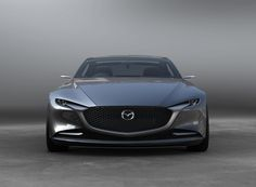 mazda'svision coupe'concept expresses a minimalist japanese aesthetic .