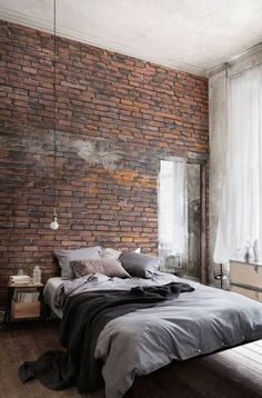 Low bed with dark neutrals; industrial details; small bedside tables
