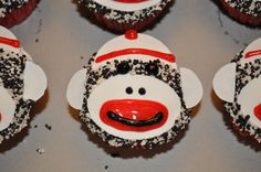 Sock Monkey Cupcakes: decorated using white icing, Wilton Sugar Sheets in white, Cookies and Cream sprinkles, red and black gel icing, baked in red and white polka dot cup liners.