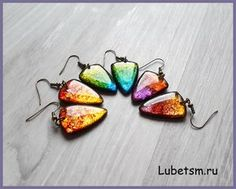 Alcohol ink colored metal leafing over polymer clay beads sealed with resin…