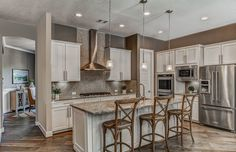 Transitional Kitchen with Destiny shaker cabinetry, Hardwood floors, Breakfast bar, Ceramic Tile, Undermount sink, L-shaped