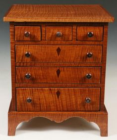 TIGER MAPLE HEPPLEWHITE SLANT TOP DESK with French foot and full