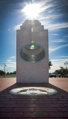 "The Anthem Veterans Memorial, Anthem, Arizona.  ""At precisely 11:11 a.m. each Veterans Day (Nov. 11), the sun's rays pass through the ellipses of the five Armed Services pillars to form a perfect solar spotlight over a mosaic of The Great Seal of the United States."""