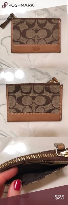 Coach wallet/coin purse Coach wallet with brown leather trim and gold hardware. Has key ring attached. Great condition Coach Bags Wallets