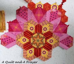 A Quilt and A Prayer version of Rosette q in my The New Hexagon - Millefiore Quilt-Along