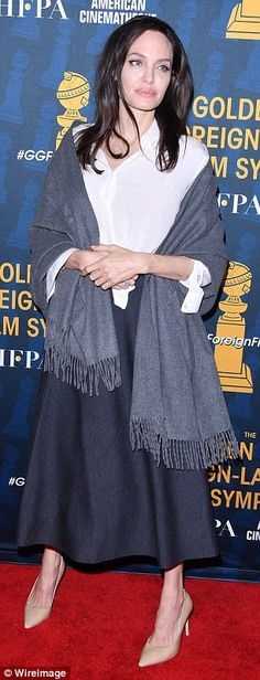 Wrap it up: Daring to impress, the Oscar winner wrapped a grey scarf around her enviable figure as her sleeves were rolled up and skirt was hemmed half calf